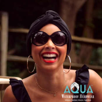 Woman Smiling Wearing A Black AQUA Waterproof Vintage Twist Turban V